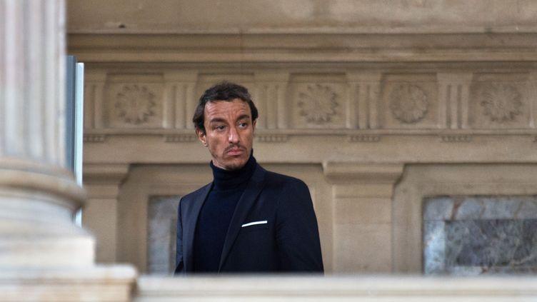L'ex-avocat Karim Achoui, le 17 septembre 2013, au palais de justice de Paris. (MARTIN BUREAU / AFP)