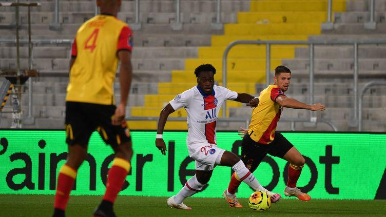 Arnaud Kalimuendo, jeune attaquant du PSG. (DENIS CHARLET / AFP)