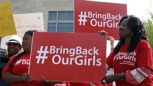 Une manifestation demandant la libération des lycéennes prises en otage par Boko Haram, le 6 mai 2014 à Washington. (ROBERT MACPHERSON / AFP)