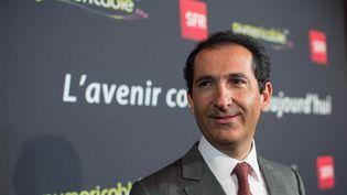 Le magnat des télécoms, Patrick Drahi, donne une conférence de presse à propos de la fusion entre SFR et Numericable, le 7 avril 2014. (ROMUALD MEIGNEUX / SIPA)