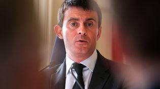 Le ministre de l'Intérieur, Manuel Valls, à Reims, le 17 décembre 2013. (FRANCOIS NASCIMBENI / AFP)