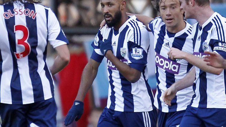 Nicolas Anelka célèbre un but, le 28 décembre 2013, lors d'un match entre West Ham et West Bromwich Albion. (IAN KINGTON / AFP)