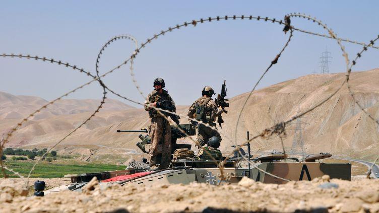 Des soldats allemands gardent un checkpoint dans la province de Baghlan, dans le nord de l'Afghanistan, le 22 août 2012. (REUTERS   )