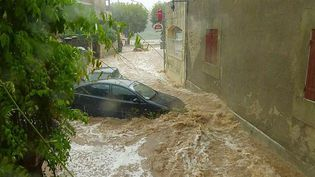 L'eau inonde les rues de Saint-Martin-d'Ardèche (Ardèche), le 9 août 2018. (MAXPPP)