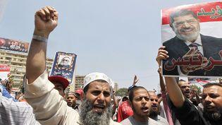 Manifestations de membres des Frères musulmans et de partisans de Mohamed Morsi, le 4 juillet 2013 au Caire (Egypte). (LOUAFI LARBI / REUTERS)