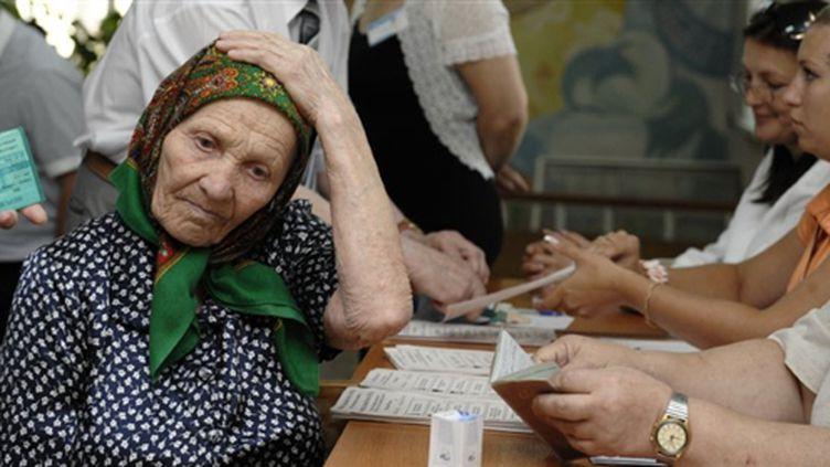 Une femme moldave attend les résultats... (© AFP Vadim Denisov)