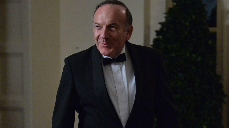 Pierre Gattaz, le président du Medef, lors de son arrivée à la Maison Blanche, à Washington, le 11 février 2014, lors du dîner d'Etat en l'honneur de François Hollande. (NICHOLAS KAMM / AFP)