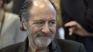 Michel Delpech au Salon du Livre de Paris le 22 mars 2014  (JOEL SAGET/AFP)
