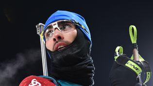 Le Français Martin Fourcade lors de l'épreuve du 10 km sprint du biathlon aux Jeux olympiques d'hiver dePyeongchang, le 11 février 2018. (FRANCK FIFE / AFP)
