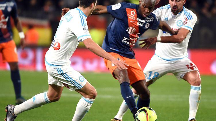 Dabo (Montpellier) pris dans la tenaille marseillaise (Isla et Manquilla) (PASCAL GUYOT / AFP)