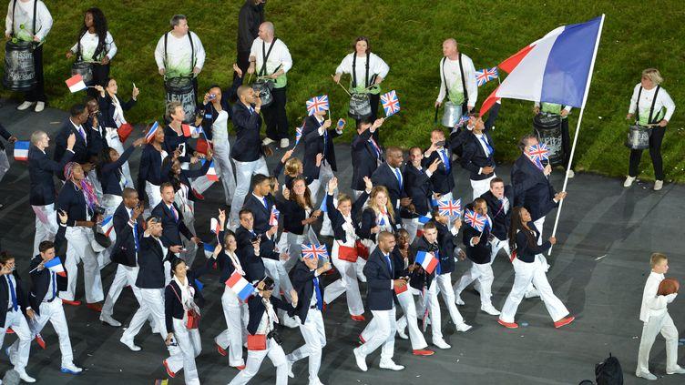 La délégation française emmenée par Laura Flessel lors de la cérémonie d'ouverture des JO de Londres (SAEED KHAN / AFP)