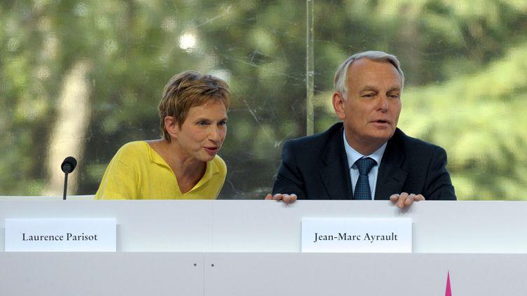La présidente du Medef et le Premier ministre,le 29 août 2012. (ERIC PIERMONT / AFP)