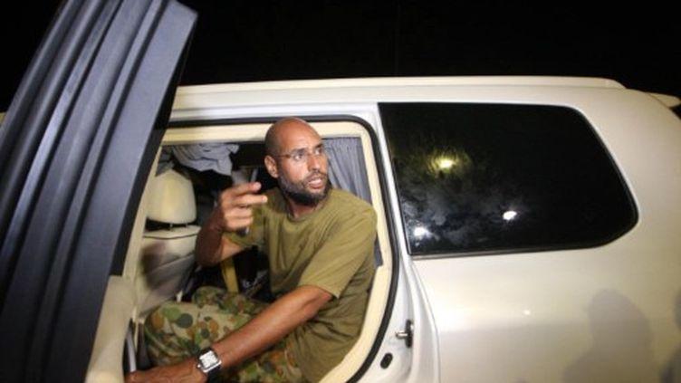 Saïf al Islam Kadhafi le 23 août 2011. (IMED LAMLOUM / AFP)