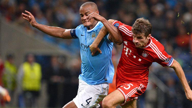 Le Bavarois Thomas Muller et le Citizen Vincent Kompany au duel l'année dernière en Ligue des champions (ANDREW YATES / AFP)