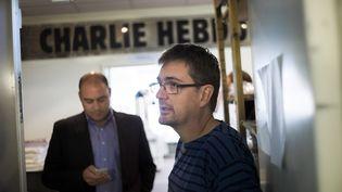 """Charb, dessinateur et directeur de la publication de """"Charlie Hebdo"""", le 19 septembre 2012 à Paris. (FRED DUFOUR / AFP)"""