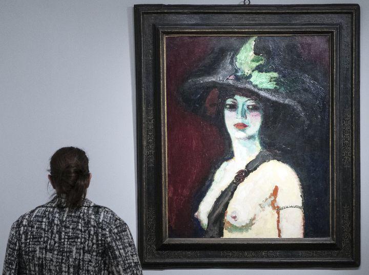 """""""Femme avec un grand chapeau""""  (ETIENNE LAURENT/EFE/Newscom/MaxPPP)"""