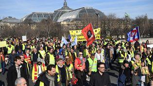 """Des """"gilets jaunes"""" manifestent à Paris, le 17 février 2019. (ERIC FEFERBERG / AFP)"""