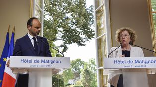 Le Premier ministre Edouard Philippe et la ministre du Travail, Muriel Pénicaud, lors d'une conférence de presse présentant les ordonnances réformant le Code du travail, jeudi 31 août à Paris. (ALAIN JOCARD / AFP)
