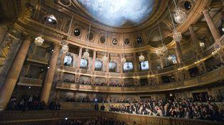 Xi Jinping et sa femme ont assisté à un concert à l'opéra Royal du château de Versailles, au côté de François Hollande. (MICHEL EULER / AFP)