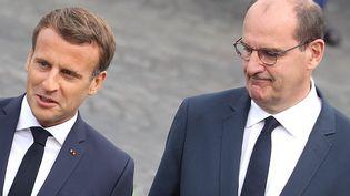 Le président de la République Emmanuel Macron et son Premier ministre Jean Castex sur la place de la Concorde lors du défilé du 14-Juillet, le 14 juillet 2020. (LUDOVIC MARIN / POOL)