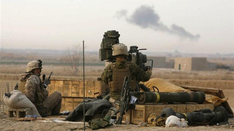 Militaires américains près de Marjah, dans le sud de l'Afganistan le 13 février 2010 (AFP PHOTO - PATRICK BAZ)