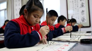 Des écoliers en Chine, le 8 octobre 2021. (LUO XUEFENG / XINHUA / AFP)