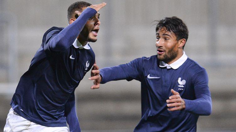 Layvin Kurzawa chambre ses adversaires après avoir marqué le but qui aurait pu qualifier les bleuets. Il n'aurait pas dû... (JONATHAN NACKSTRAND / AFP)