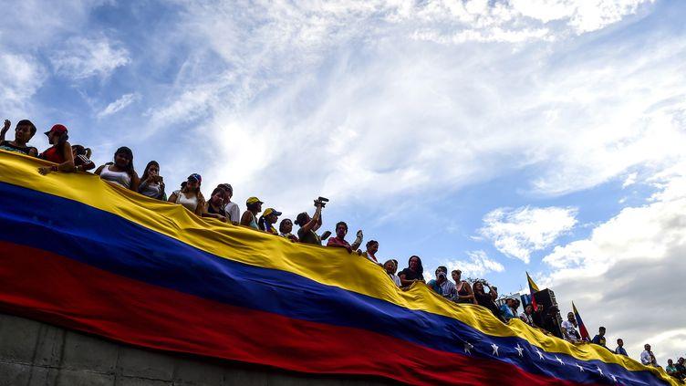 L'opposition venezueliennne manifeste le 24 juillet 2017, à Caracas. (RONALDO SCHEMIDT / AFP)
