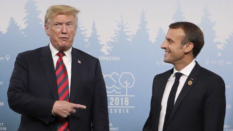 Donald Trump et Emmanuel Macron lors du G7, à La Malbaie, au Québec, le 8 juin 2018. (LUDOVIC MARIN / AFP)