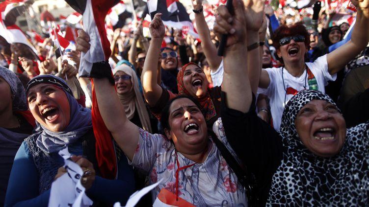 Des Egyptiennes manifestent contre le président déchuMohamed Morsi, au Caire (Egypte), le 3 juillet 2013. (MAHMOUD KHALED / AFP)
