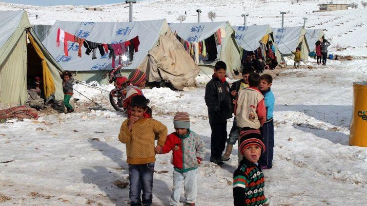 Des enfants syriens dans un camp de réfugiés à Arsal, au Liban, le 13 décembre 2013. ( AFP )
