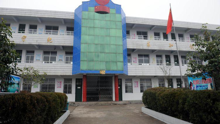 """L'homme qui a agressé 22 enfants dans cette école primaire du district de Guangshan (centre-est de la Chine) était """"sous l'influence"""" des théories de la fin du monde, selon la police, le 15 décembre 2012. (LI BO / XINHUA / AFP)"""