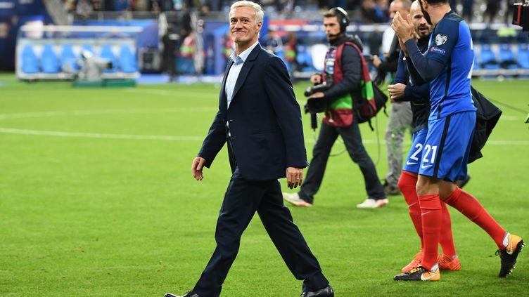 Didier Deschamps, satisfait de la qualification de ses joueurs pour le Mondial 2018 (FRANCK FIFE / AFP)