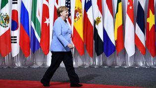 La chancelière allemande Angela Merkel, lors du sommet du G20 à Osaka (Japon), le 28 juin 2019. (BRENDAN SMIALOWSKI / AFP)