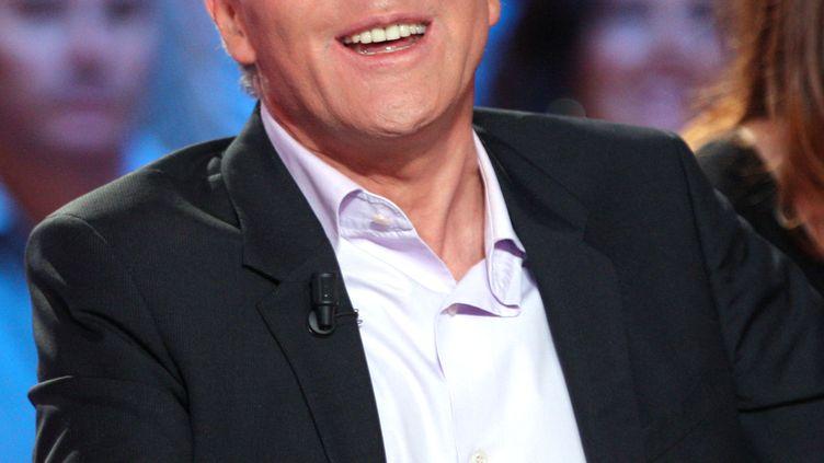 """Laurent Ruquier, sur le plateau du """"Grand Journal"""" de Canal+, le 24 septembre 2008. (PATRICK KOVARIK / AFP)"""