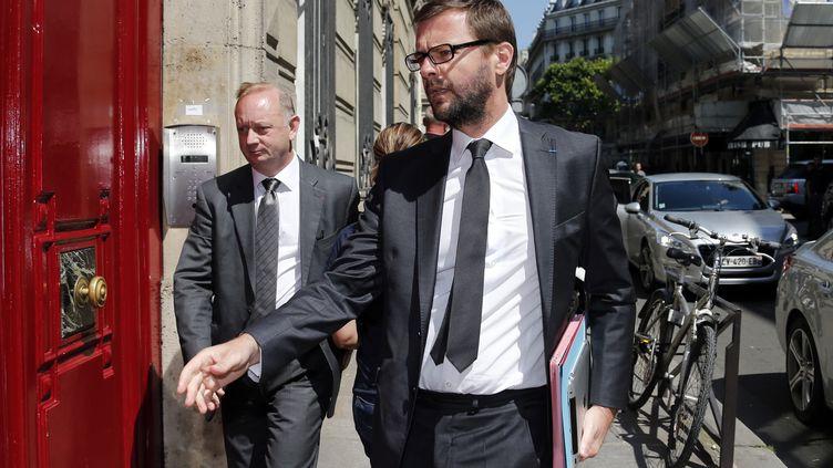 Eric Cesari (à G) et Jérôme Lavrilleux, à leur arrivée dans les bureaux de Nicolas Sarkozy le 8 juillet 2013 à Paris. ( BENOIT TESSIER / REUTERS )