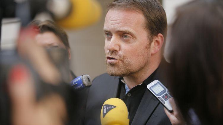 Bastien Millot, le cofondateur de Bygmalion, à Paris, le 1er octobre 2014, jour de sa mise en examen dans l'affaire des comptes de campagne de Nicolas Sarkozy. (MATTHIEU ALEXANDRE / AFP)