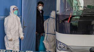 Des enquêteurs de l'OMS, présents en Chine,pour enquêter et remonter jusqu'à l'origine du virus du Covid19 (14 janvier 2021). (NICOLAS ASFOURI / AFP)