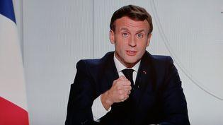 Emmanuel Macron lors de son allocution dans laquelle il a annoncé un reconfinement du territoire national, le 28 octobre 2020. (LUDOVIC MARIN / AFP)
