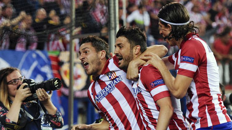 Les joueurs de l'Atletico Madrid Koke, David Villa et Filipe Luiz