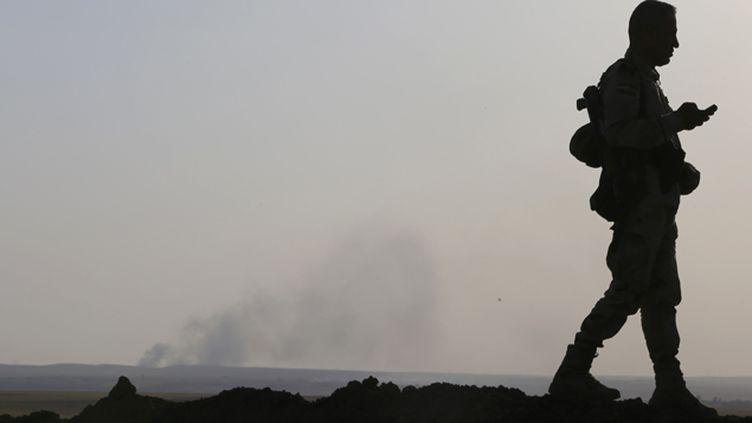 (Après une frappe américaine près de Mossoul en Irak © REUTERS / Ahmed Jadallah)