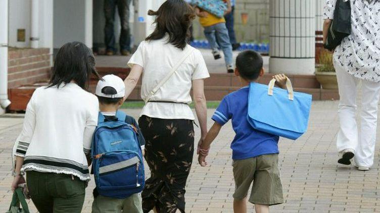 Au Japon, face à la pauvreté, les femmes et les enfants sont les plus vulnérables. (STR / JIJI PRESS / AFP)