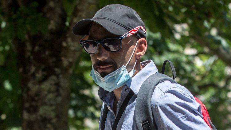 Cédric Jubillar, le mari de Delphine Jubillar, lors d'une marche pour les six mois de la disparition de sa femme, à Albi (Tarn), le 12 juin 2021. (FRED SCHEIBER / AFP)