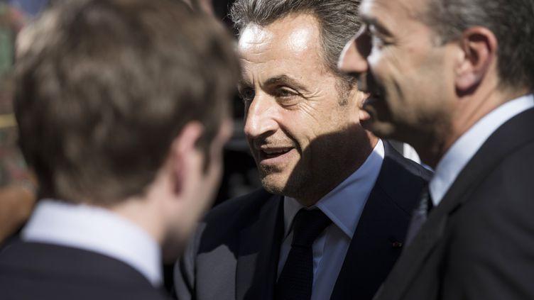 Nicolas Sarkozy lors de son arrivée au siège de l'UMP, à Paris, le 8 juillet 2013. (FRED DUFOUR / AFP)