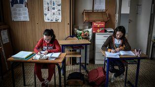 L'Association des maires d'Île-de-France appelle à ce quela réouverture des écoles soit repoussée à une date ultérieure dans les départements qui seront classés en rouge. (STEPHANE DE SAKUTIN / AFP)