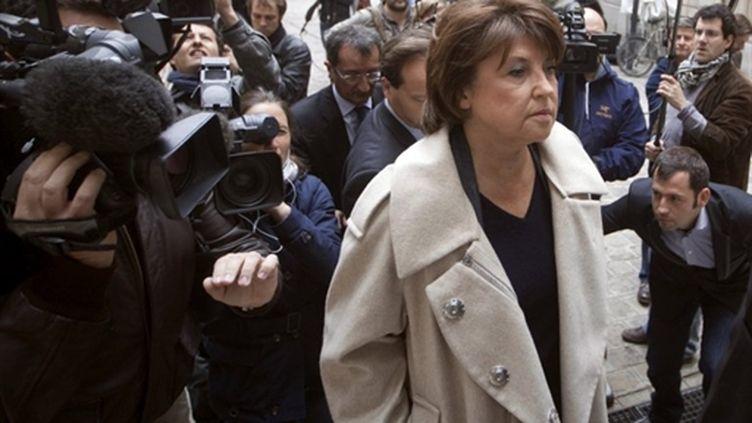 Martine Aubry arrive au siège du Parti socialiste, rue Solferino à Paris, le 17 mai 2011. (AFP - Joel Saget)