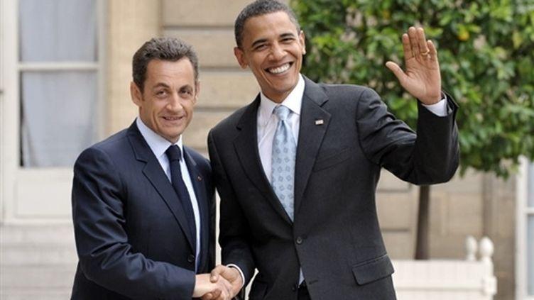 Nicolas Sarkozy accueille Barack Obama à l'Elysée (25/07/2008) pendant sa campagne (© AFP/Eric Feferberg)