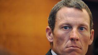 """Si Lance Armstrong abandonne, """"c'esttoute sa fondation contre le cancer qui se casse la gueule"""", selon le journaliste Pierre Ballester. (TIZIANA FABI / AFP)"""