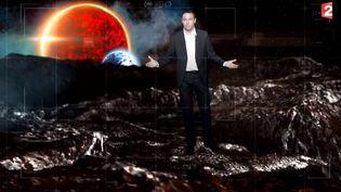 Christophe de Vallambras de France 2 explique l'importance de la mission Rosetta sur le plateau du journal de 20 heures, le 11 november 2014. ( FRANCK PARISIS - FRANCE 2)