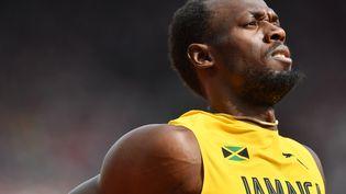 Le Jamaïcain Usain Bolt lors de la demi-finale du relais 4x100m, samedi 12 août 2017 à Londres (Royaume-Uni), lors des championnats du monde d'athlétisme. (BEN STANSALL / AFP)